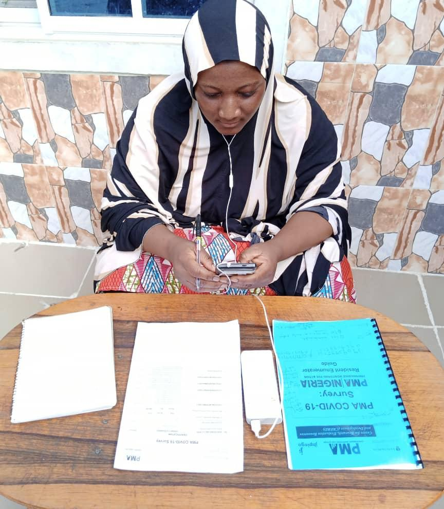 Nigerian woman at table with documents